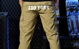 4折!ZOO YORK/佐约克骷髅徽章背后字母男束脚裤休闲裤