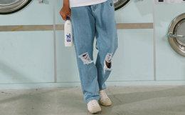 6折!TYAKASHA塔卡沙芝麻街系列直筒破洞布标水洗牛仔裤