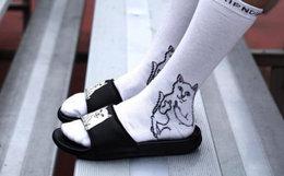 5.7折!RIPNDIP 中指贱猫猫咪压印情侣凉鞋街头风拖鞋