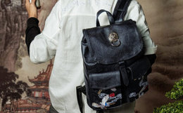 3.6折!初弎中国风刺绣仙鹤狮子头方形双肩包男女背包